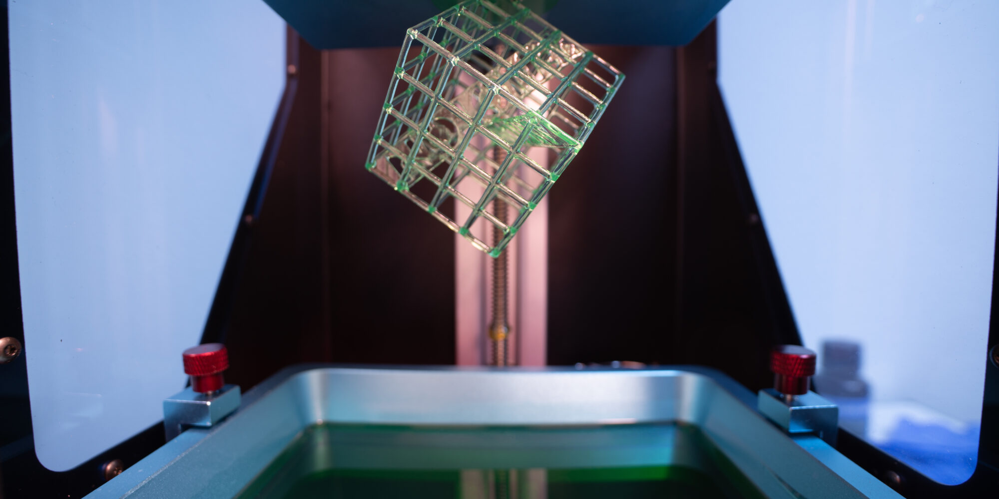 DLP and SLA 3D-printing are both Vat photopolymerization processes where a photopolymer bed is exposed to UV light to shape a 3D-printed object.